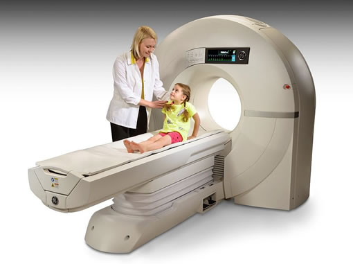 A child and a doctor near a cardiac CT